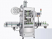 Labelling machine for applying sleeve labels slevarna label