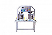 Aseptic automatic filler with two heads